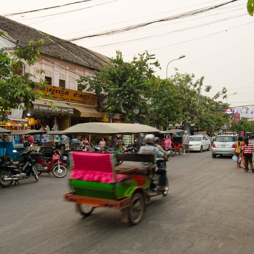 A tuk tuk speeding through the busy pub street in Siem Reap, Cambodia.