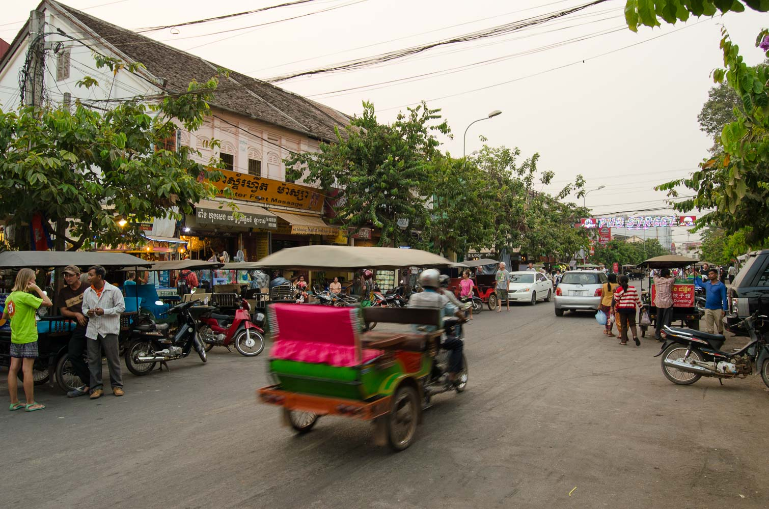 A tuk tuk speeding through the busy pub street in Siem Reap, Cambodia.