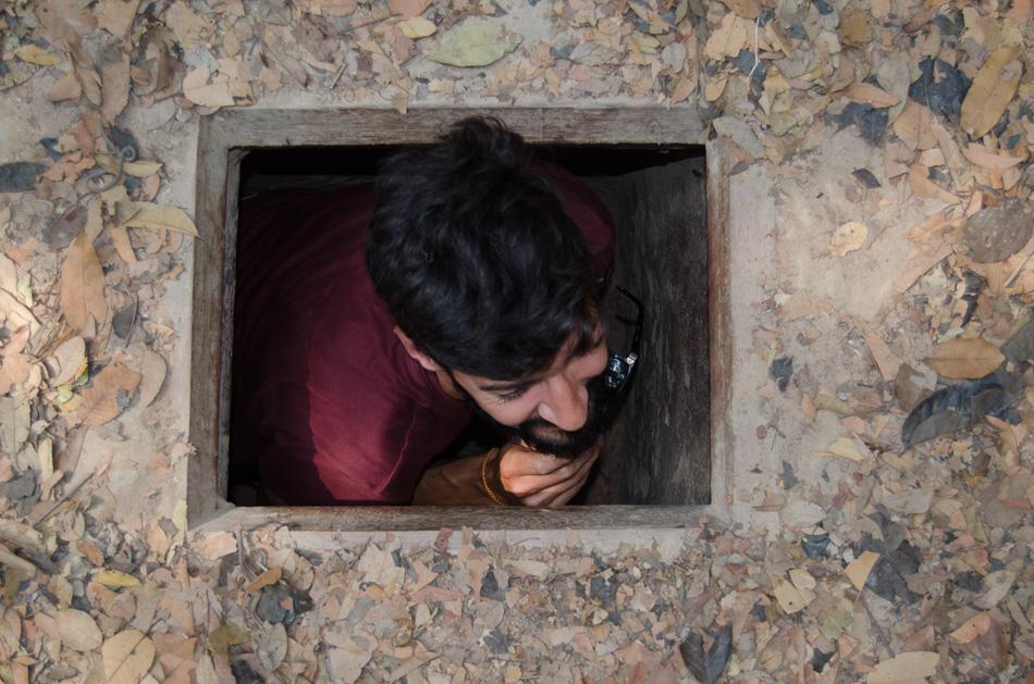 Nuno entering the Cu Chi tunnel