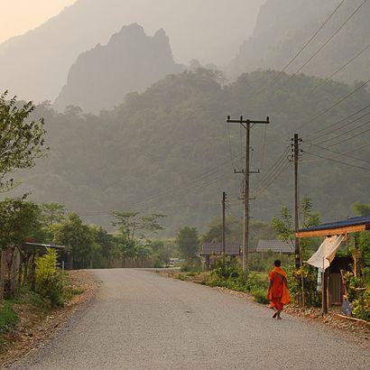 Monk walking alone in Laos